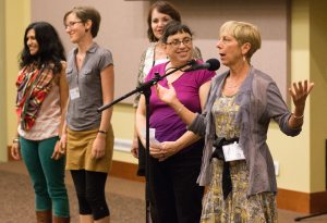Kelly at the Power of Words conference while Caryn Mirriam-Goldberg, ronda Miller, Teri Grunthaner, and Seema Reza look on