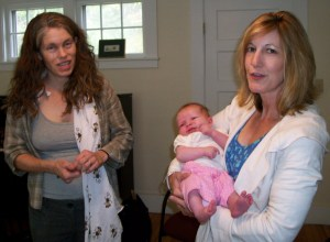 Kristina Keefe-Perry, and past council member Suzanne Adams holding Kristina and Callid's then-baby (and first TLA baby!) Nahar.